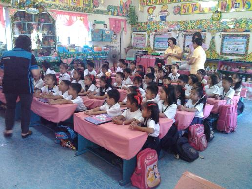Ms. Mactal, telling story to pupils in Turo Elementary School