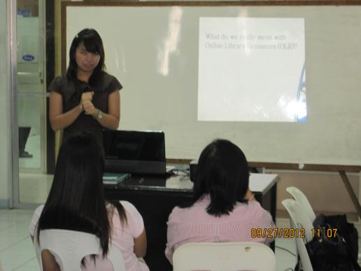 Ms. Bea Castillo, Solution Specialist from CE-Logic, giving product information...