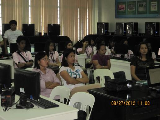 CBA Dean Balboa with faculty and students attentively listening to the Speaker...