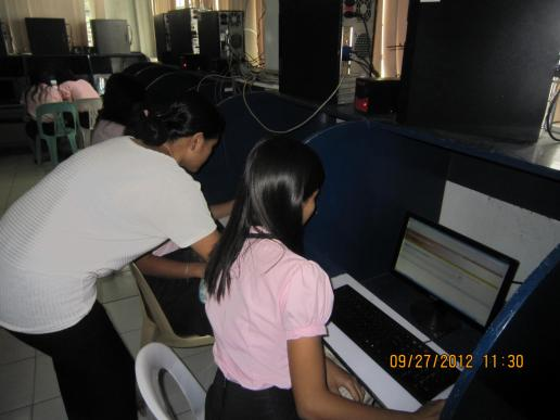 Ms. Galang, the Chief Librarian, assisting CBA students to access Infotrac site...