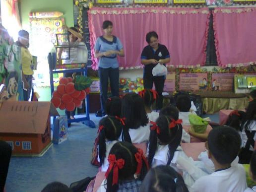 Ms. Ana, assisting Ms. Mactal in giving prizes.